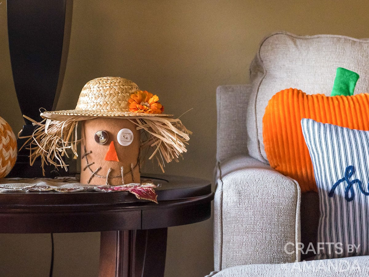 Coffee Can Scarecrow on table next to couch