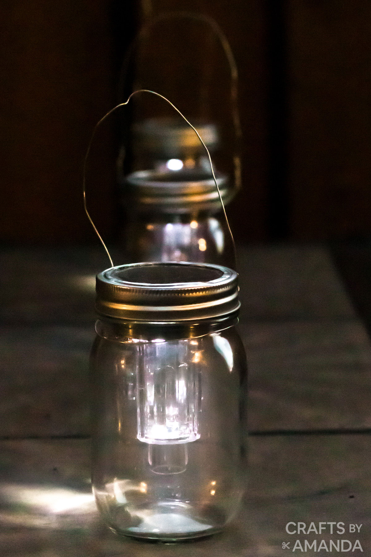 mason jar solar light at night on a table