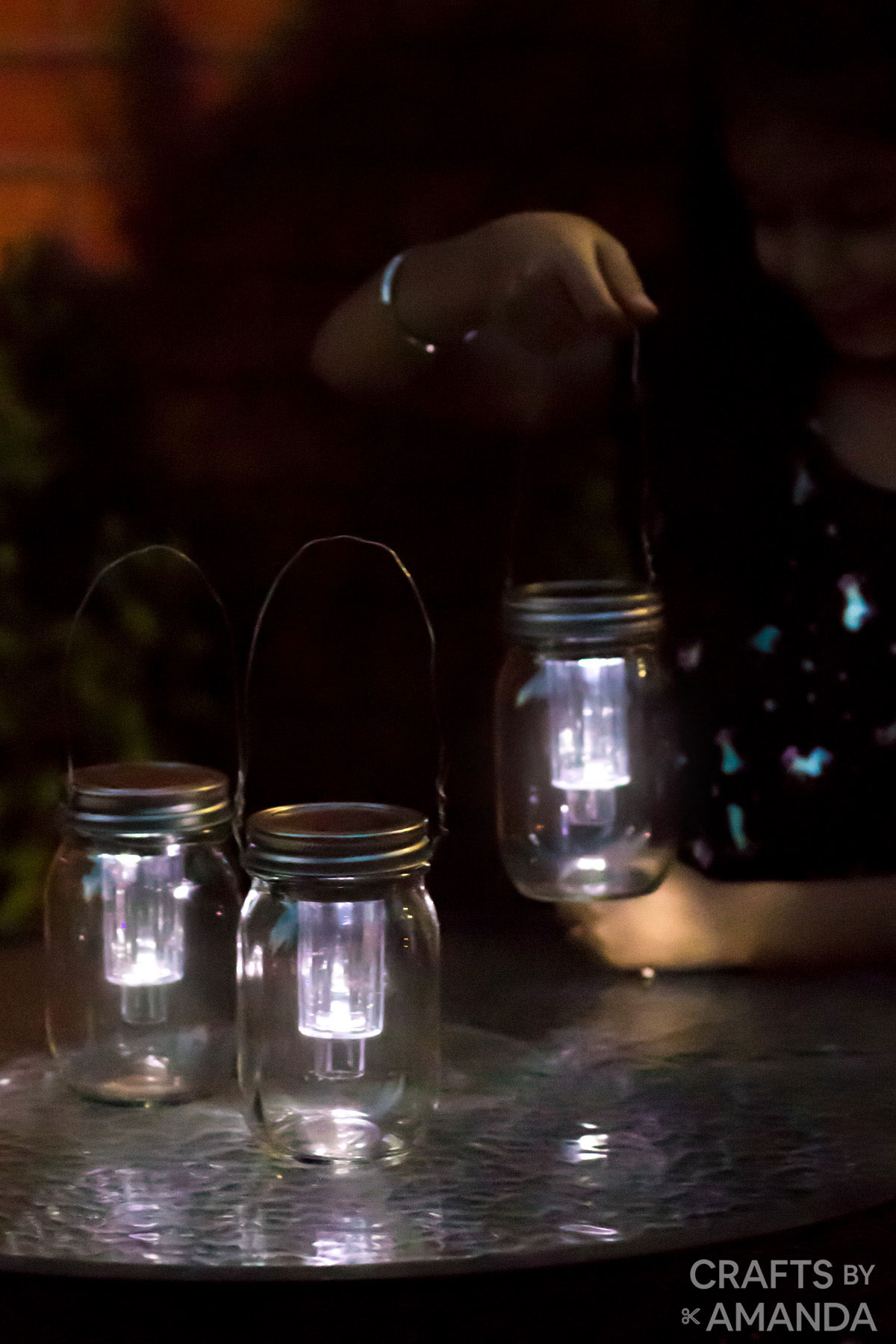little girl near table with solar lights