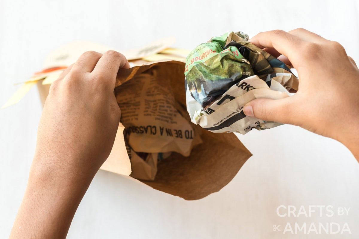 filling bag with crumpled newspaper