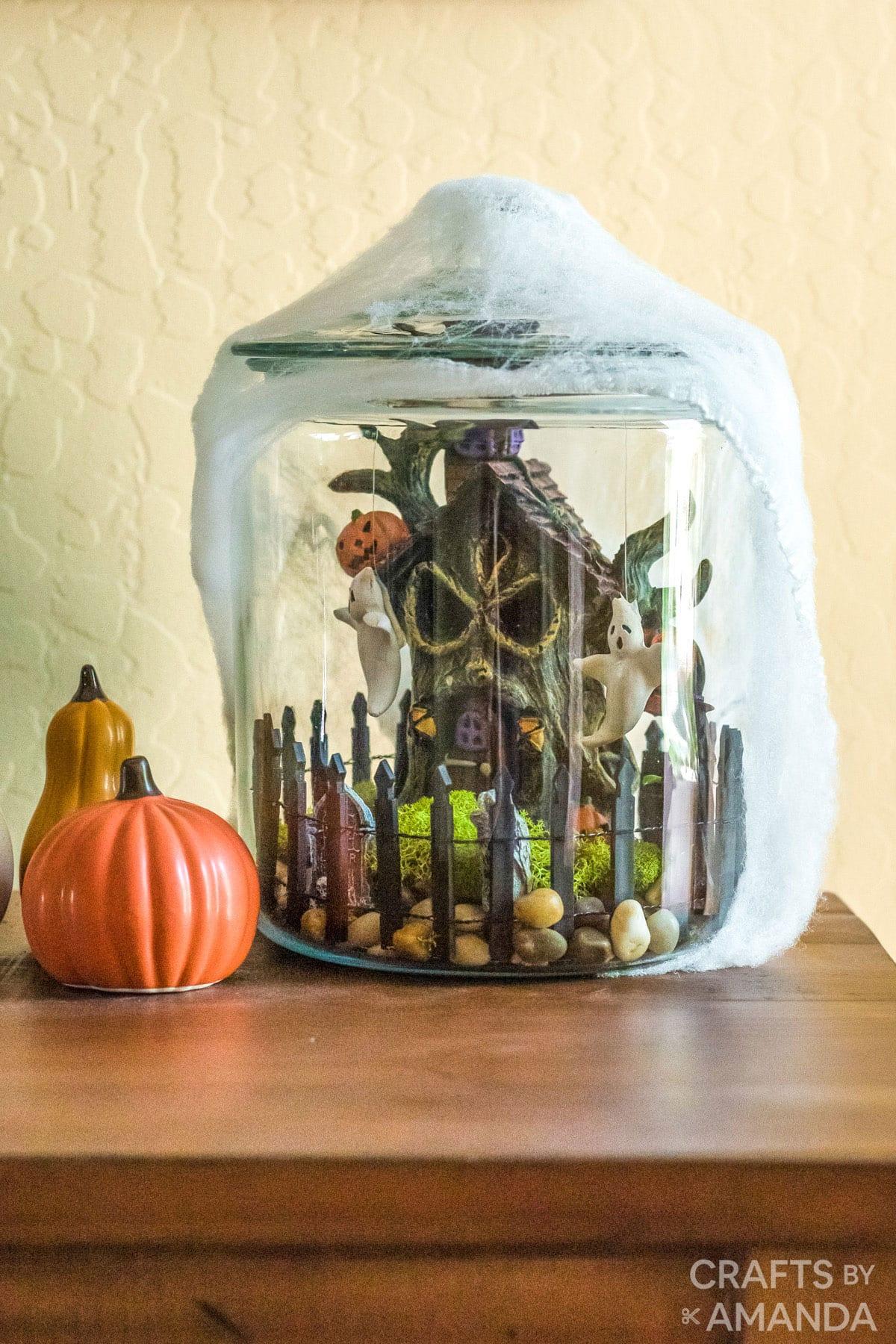 Halloween terrarium on fireplace mantel