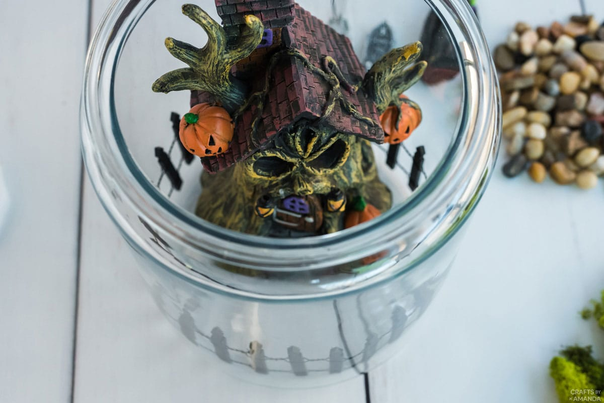 haunted house figurine inside glass canister