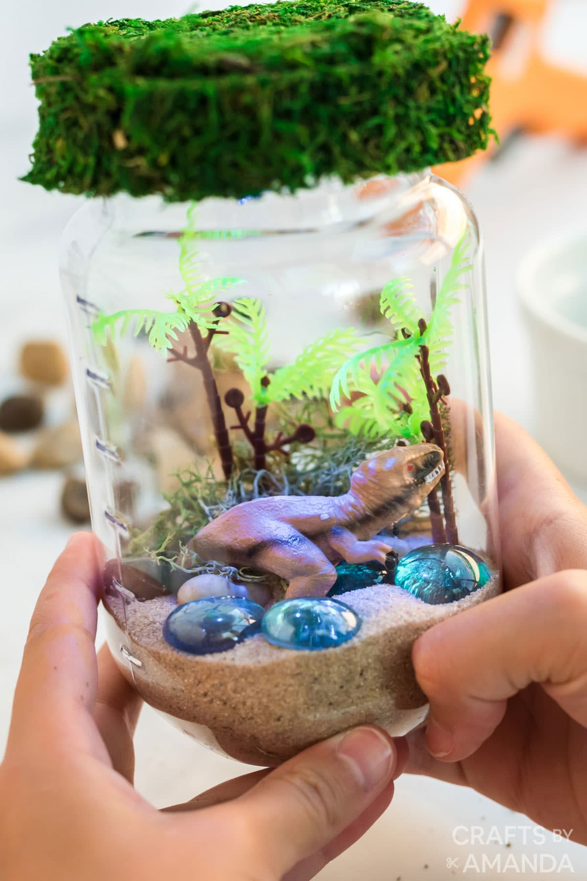 child holding dinosaur terrarium nightlight