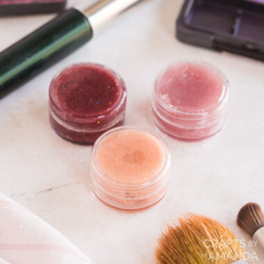 3 lip glosses with make up around them