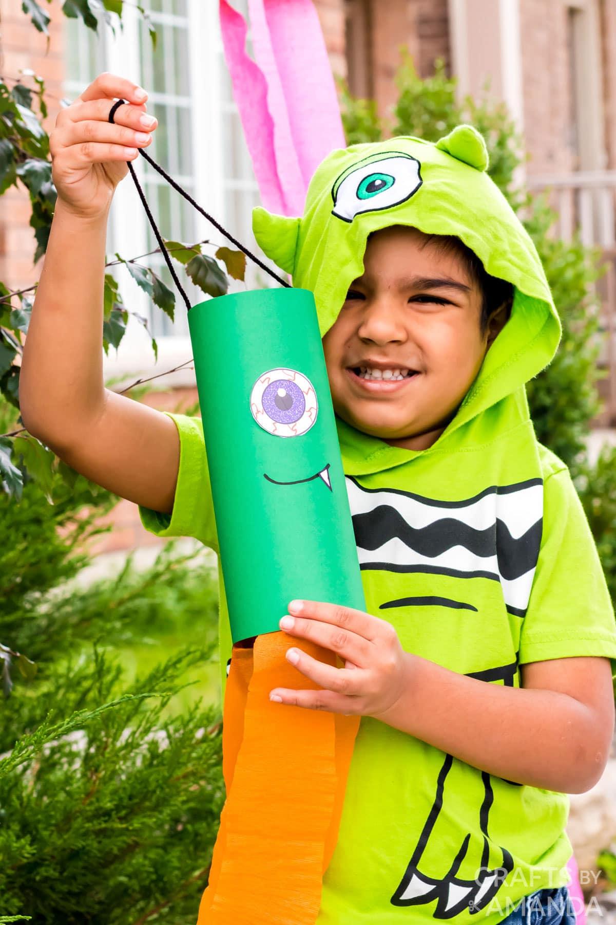 child holding monster windsock