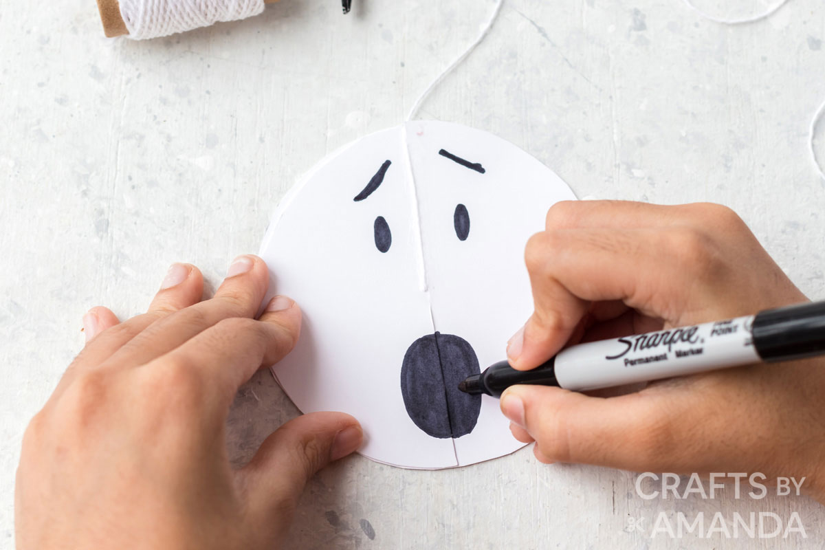 drawing face on paper ghost