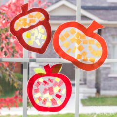 paper sun catchers hanging in window