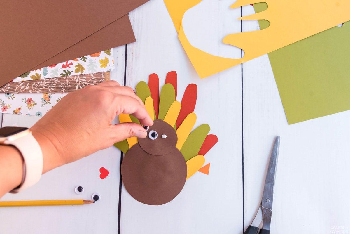 placing googly eye onto turkey head