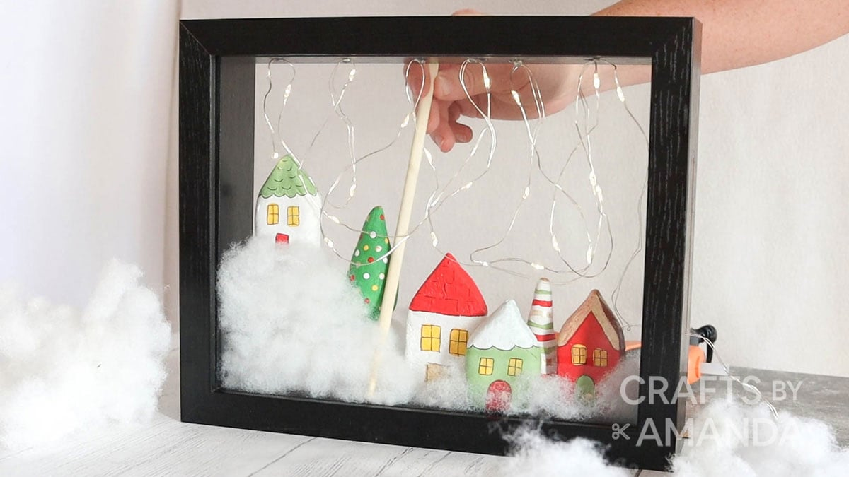 using stick to adjust items in shadowbox