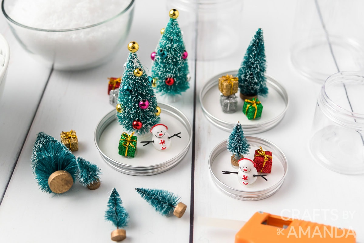 holiday figurines glued to jar lids