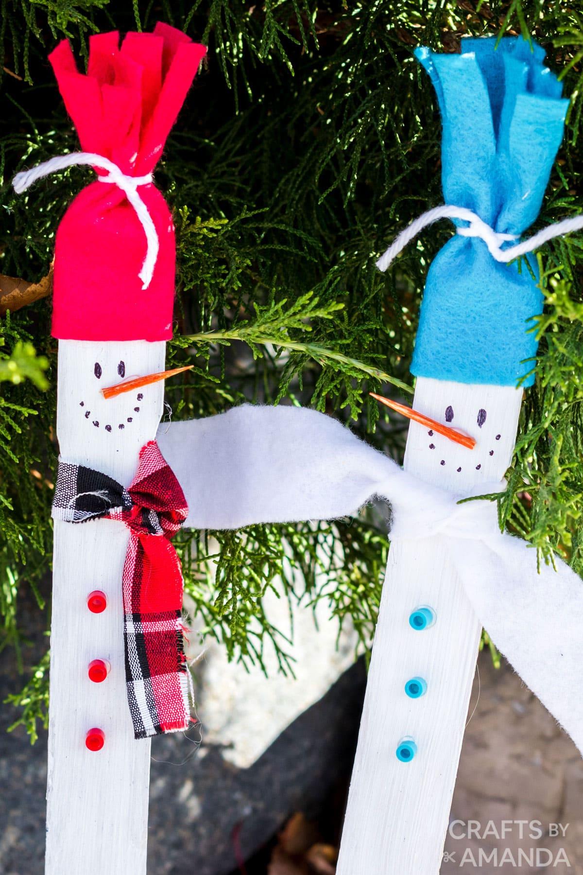 snowmen made from paint sticks