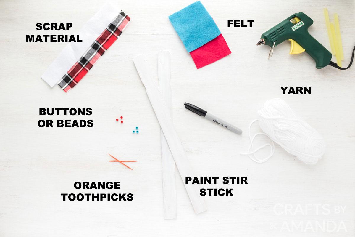 labeled supplies for paint stick snowmen
