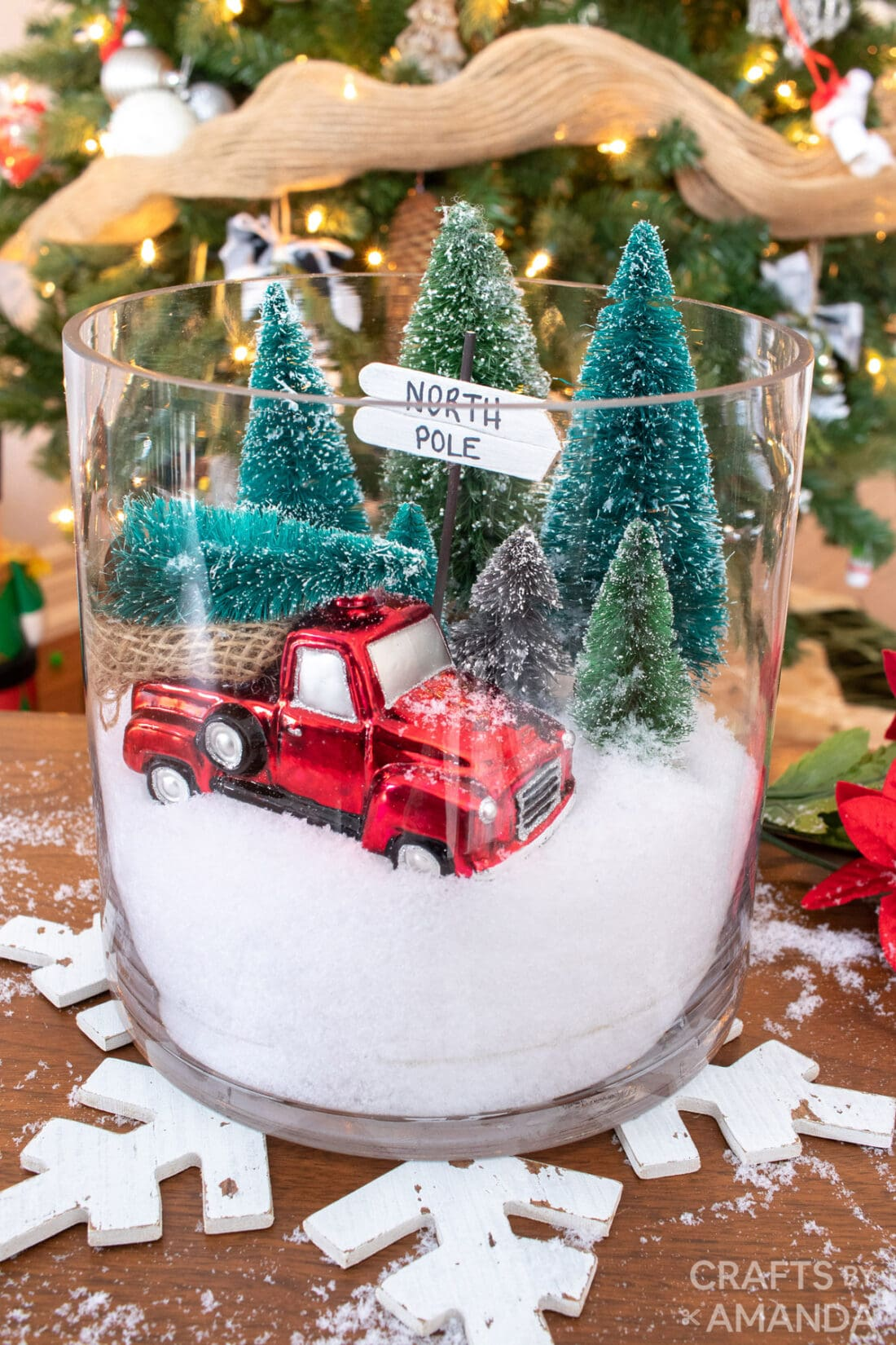 GLASS CONTAINER WITH RED TRUCK AND BOTTLE BRUSH TREES