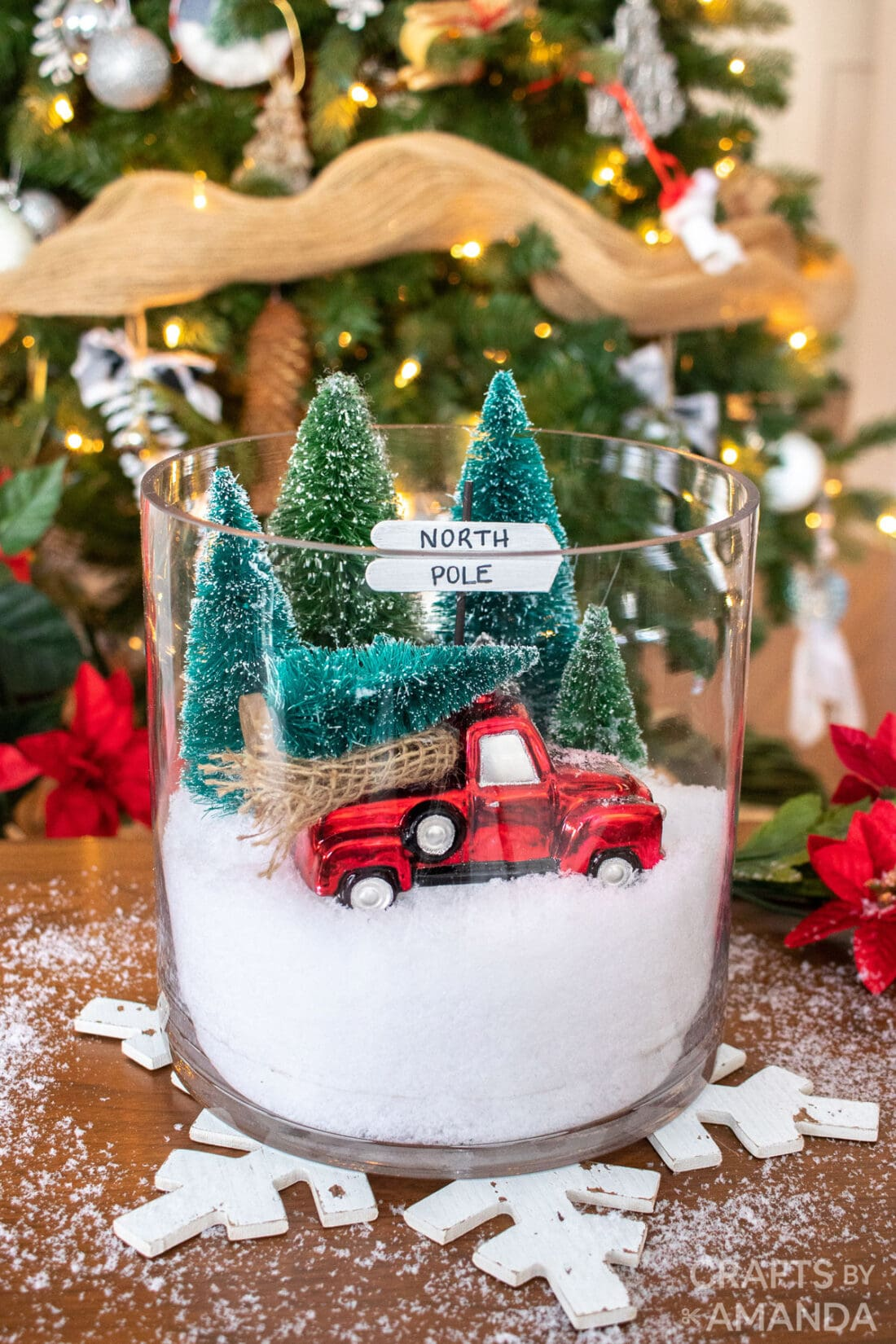 christmas terrarium with winter scene and red truck