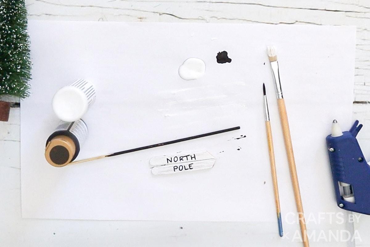 north pole written on white sticks