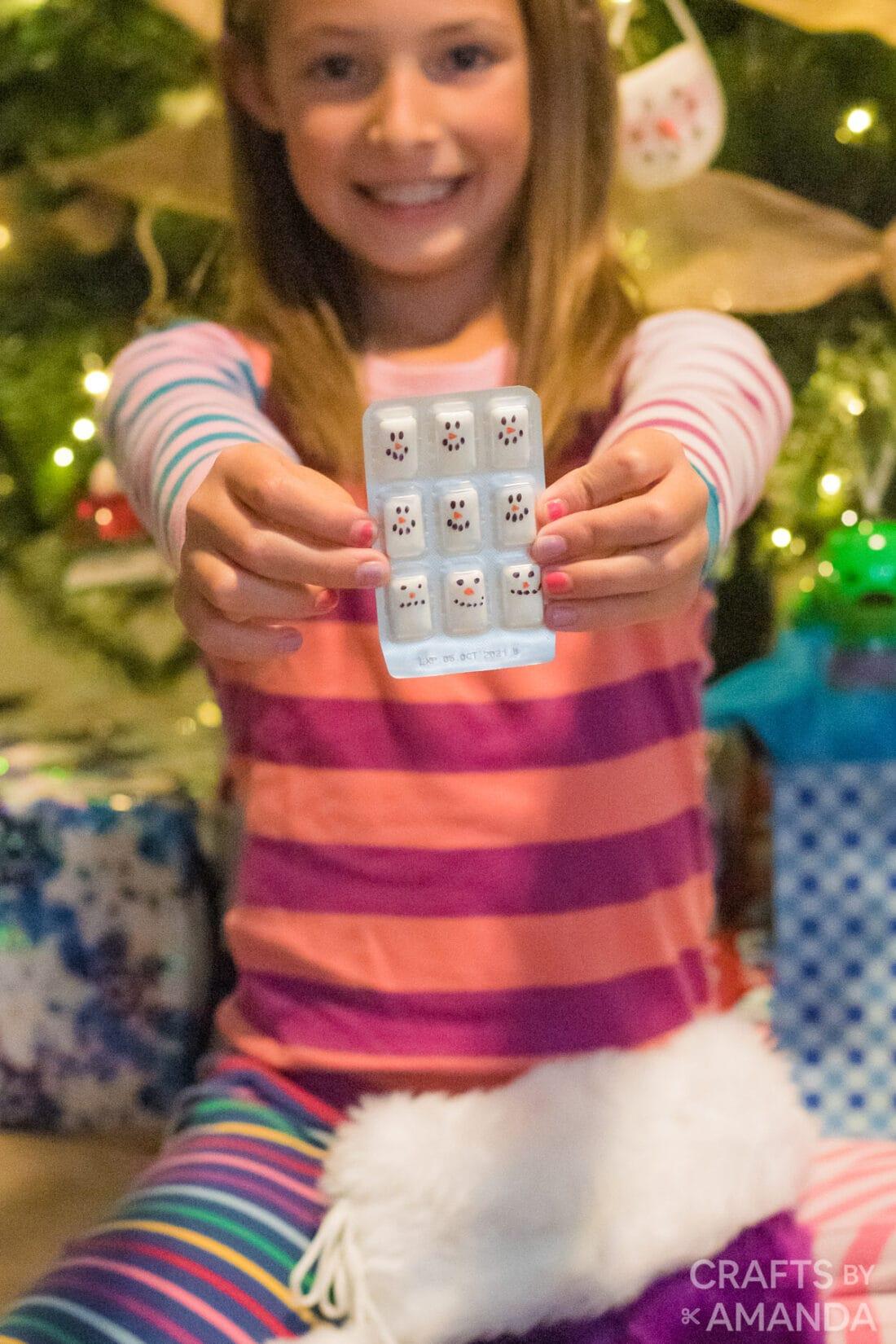 girl holding snowman gum