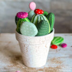 cactus painted rocks in a clay pot