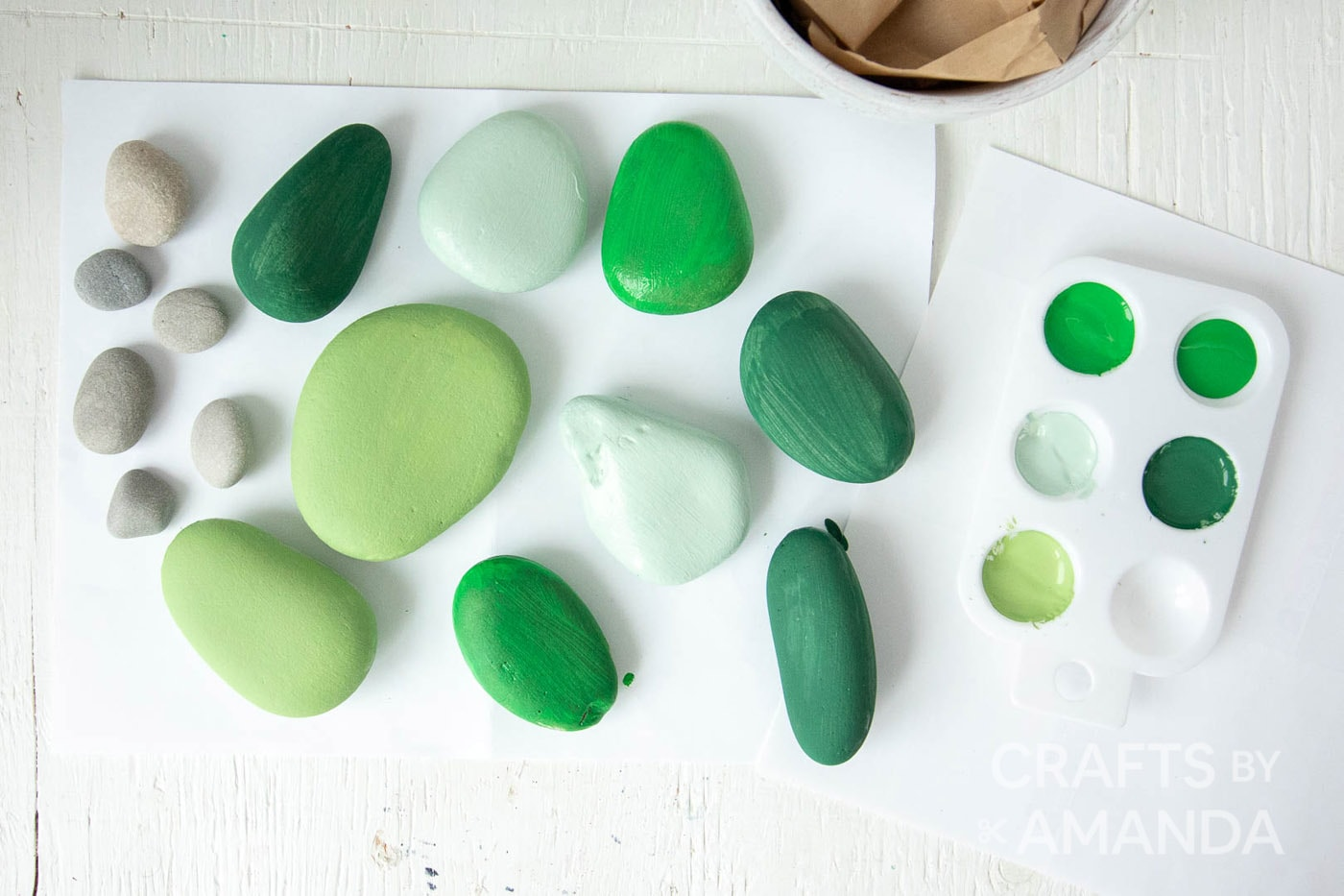 several painted rocks on white table