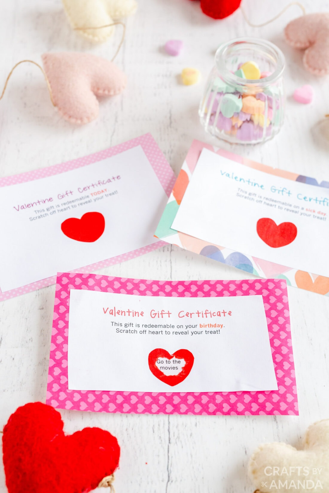 3 valentine gift certificates on a table