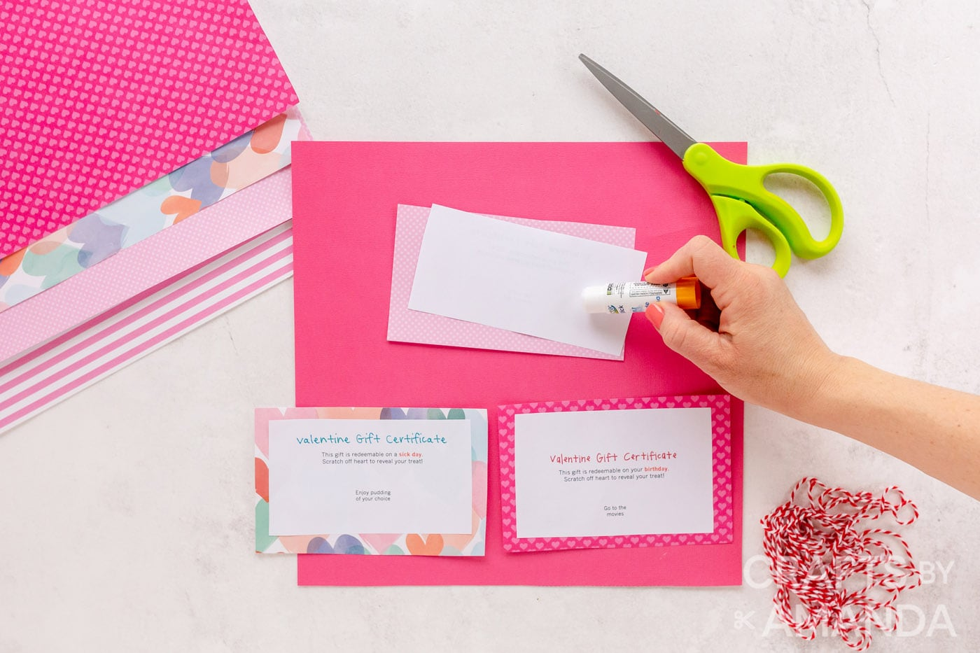 use a glue stick to adhere to the scrapbook paper