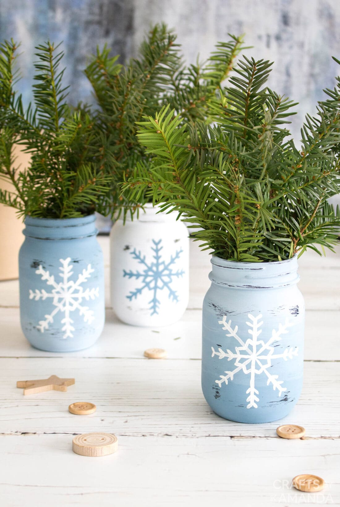 3 snowflake painted mason jars