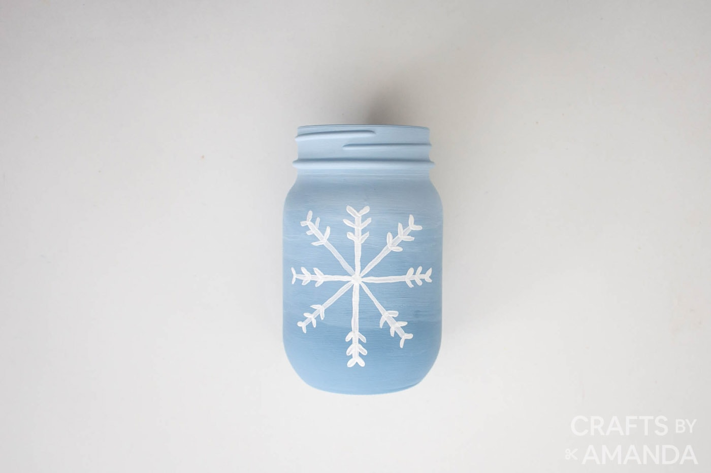 snowflake painted on jar