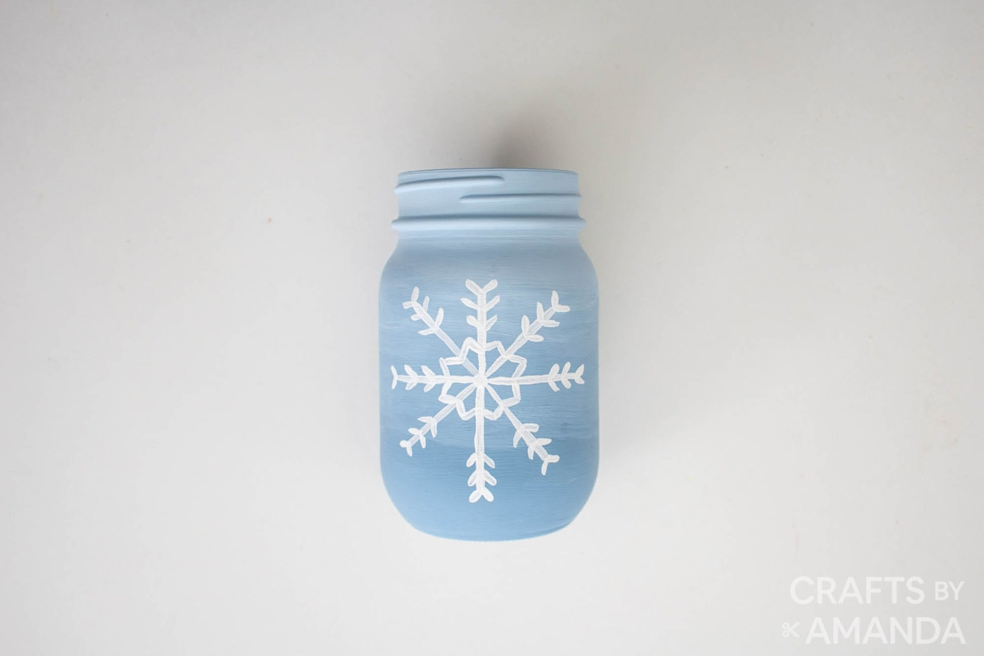 snowflake painted on blue jar