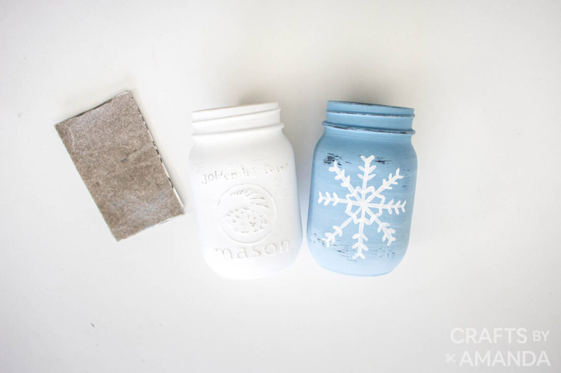 two painted jars with a piece of sandpaper