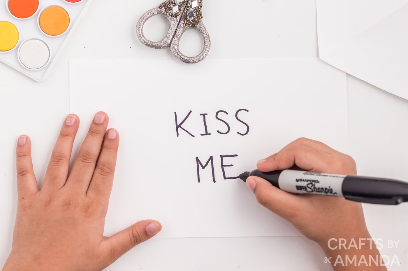 using a sharpie to write valentine message on paper