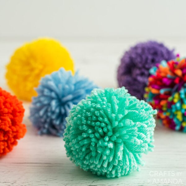 https://craftsbyamanda.com/wp-content/uploads/2021/02/How-to-Make-a-Pom-Pom-SQRC-600x600.jpg