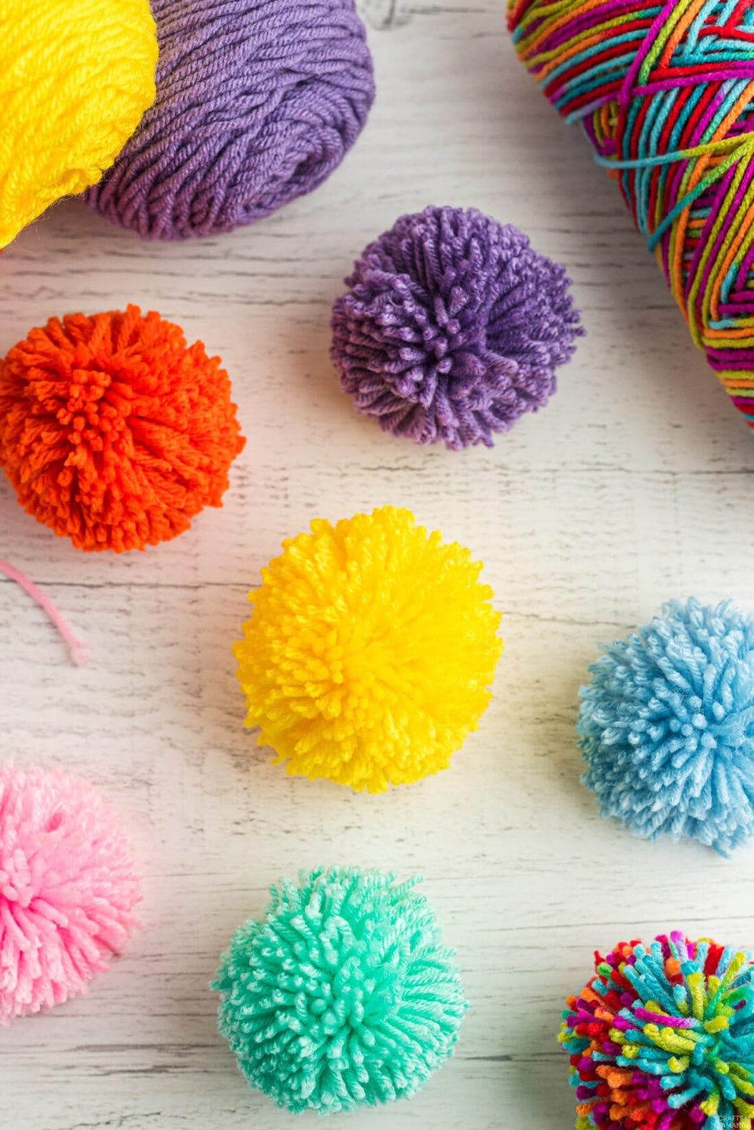colorful yarn pom poms