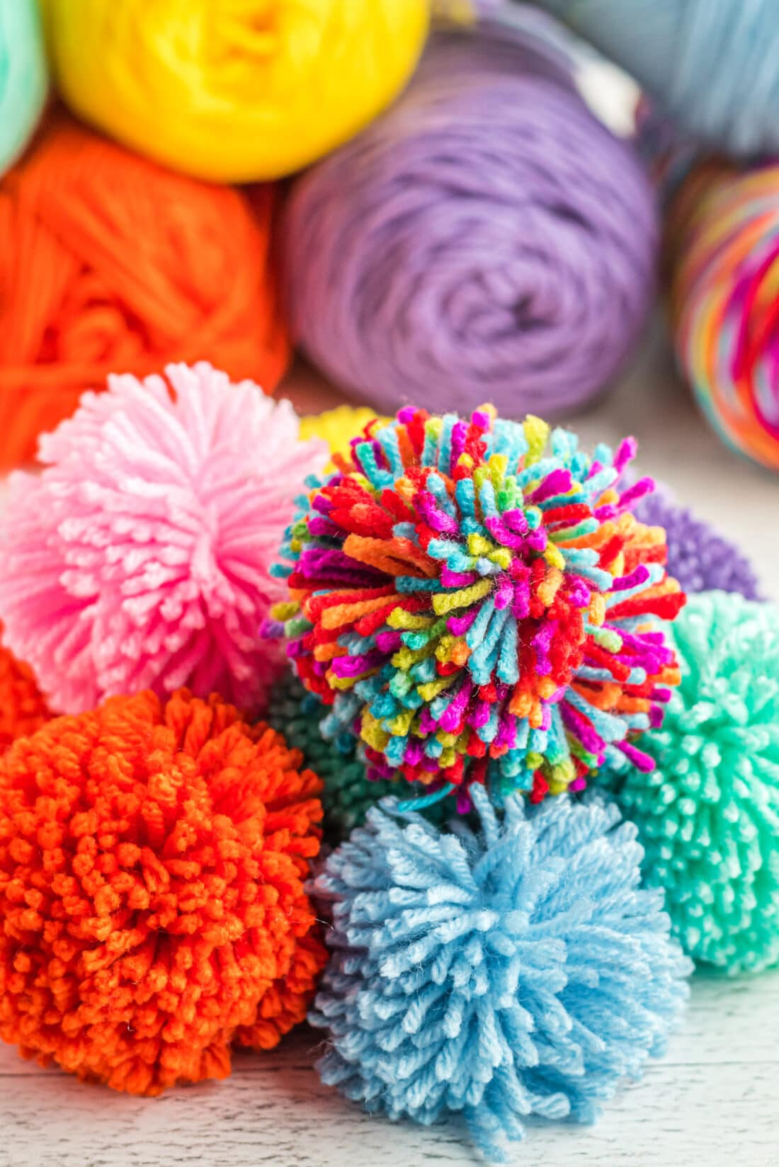 yarn pom poms piled on each other