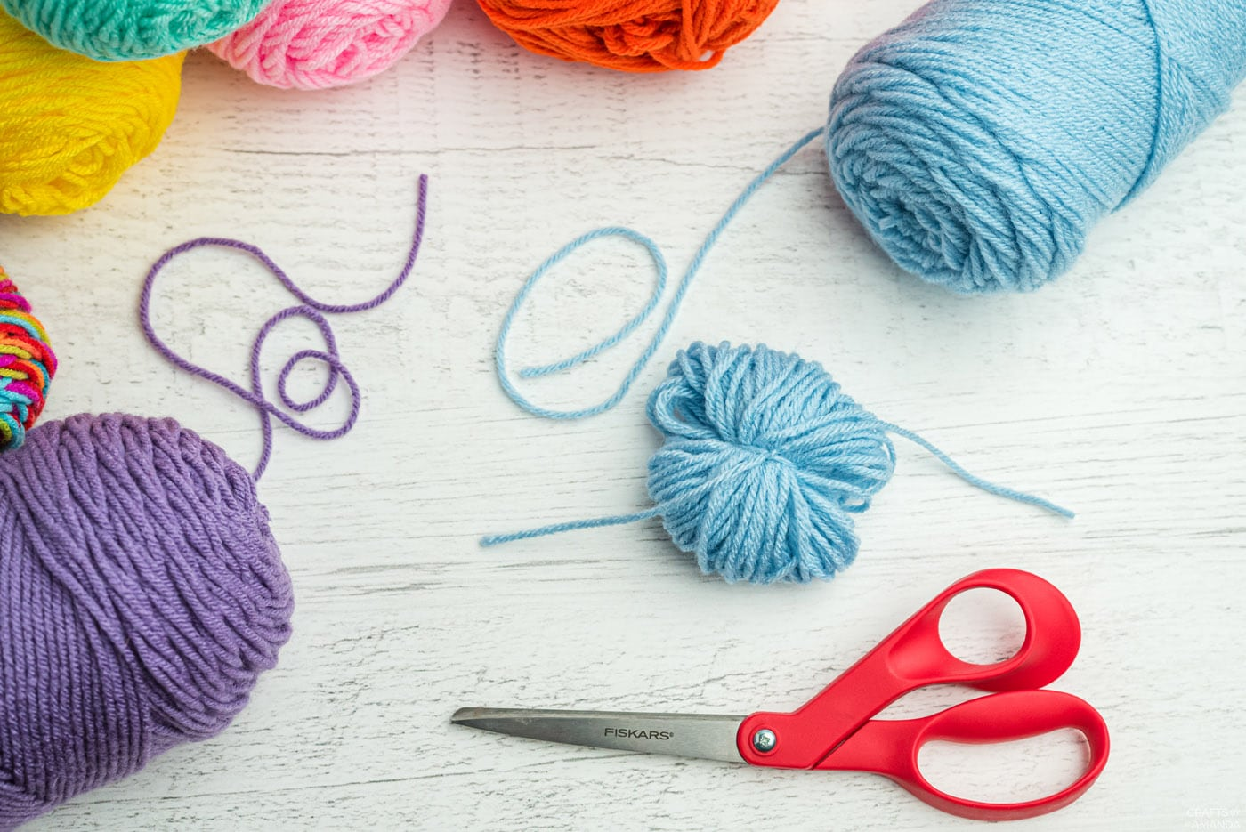 tie a knot around your yarn loops