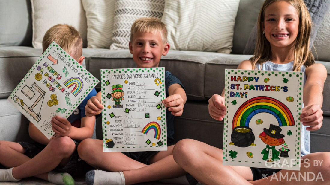 children holding up St. Patrick's Day Activity Sheets