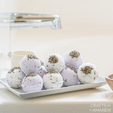 lavender bath bombs on a tray by the tub