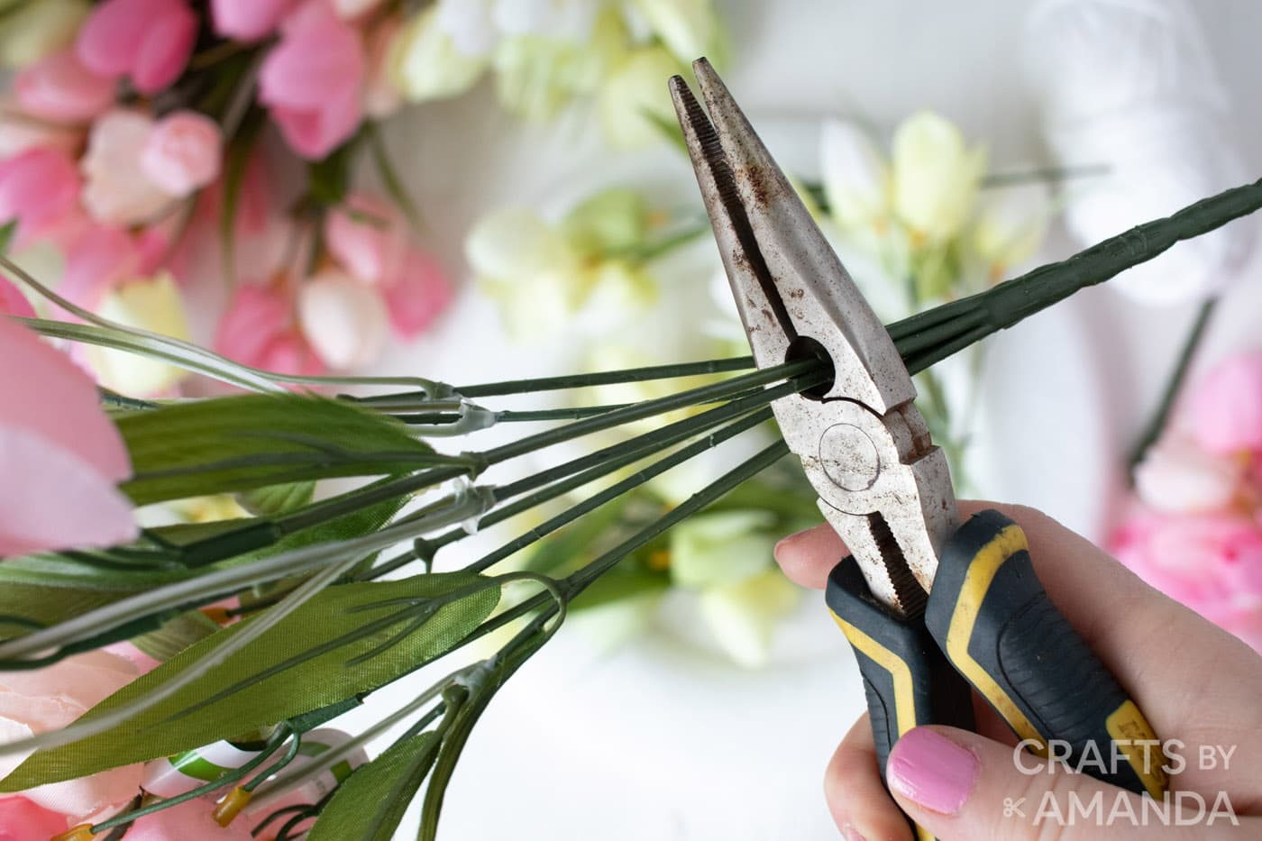 using wire cutters to snip off stem of the tulips