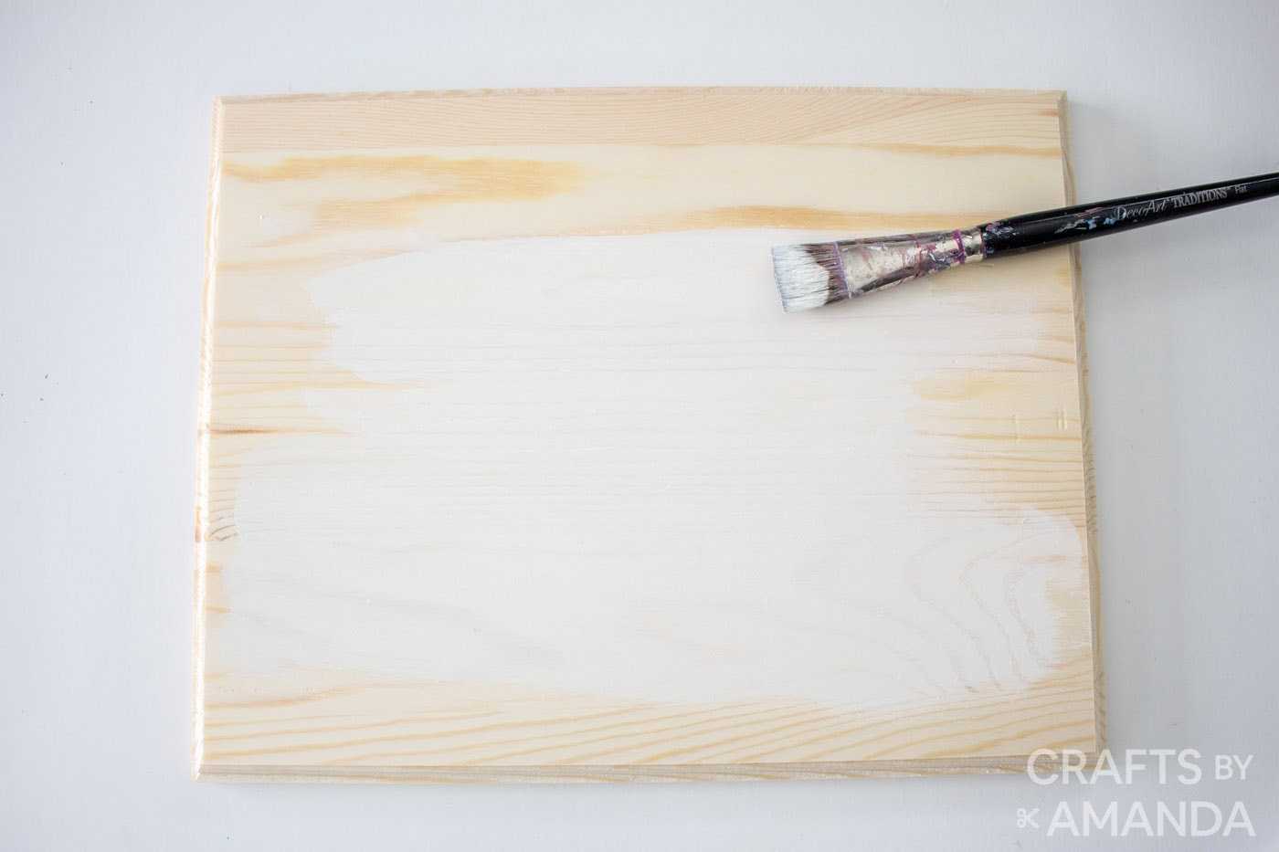 painting the wood plaque in white