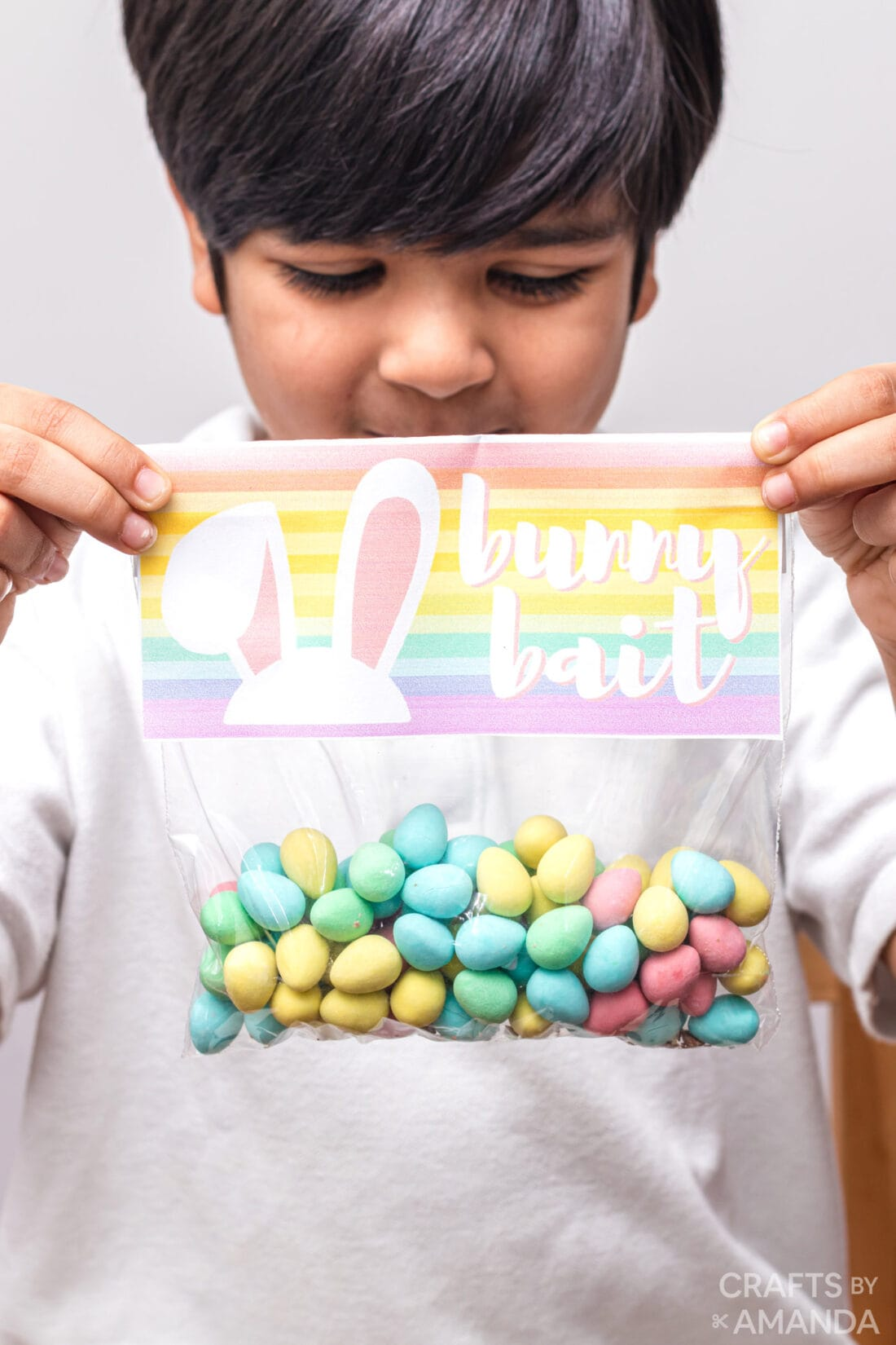 little boy holding bag of easter candy