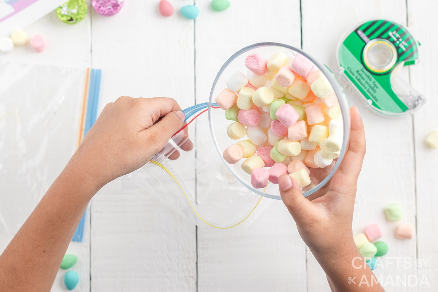 pouring mini marshmallows into a sandwich bag
