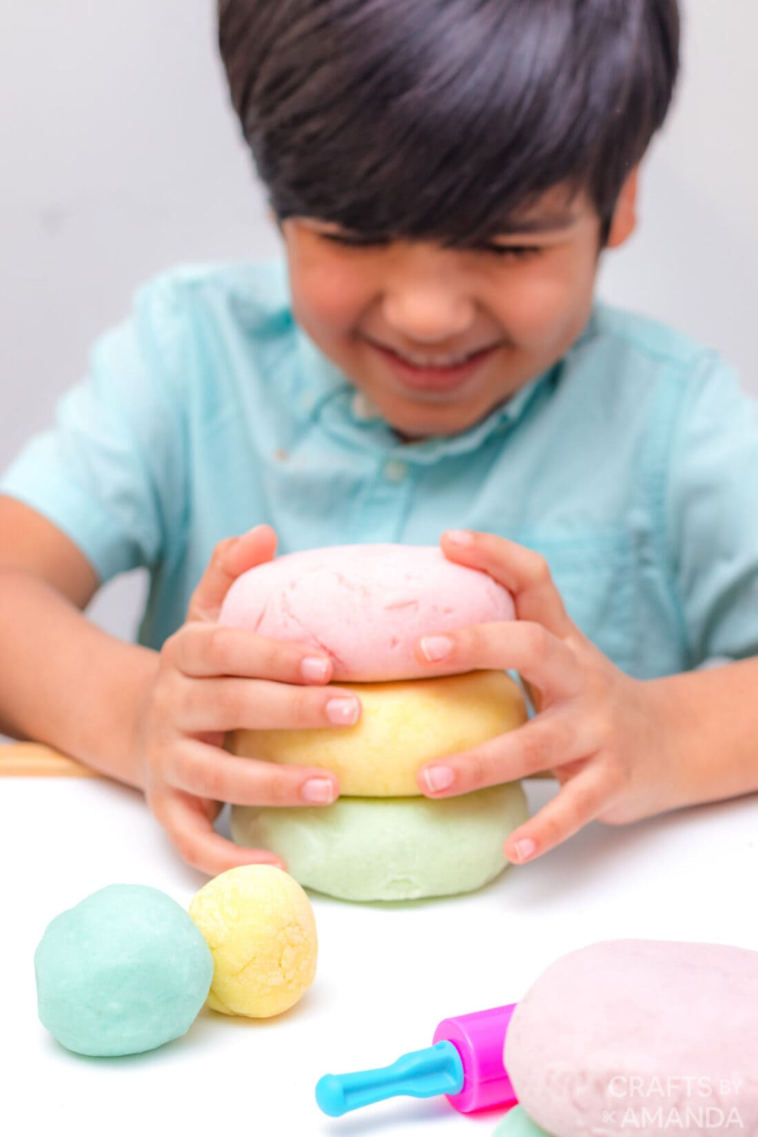 boy holding easter play dough