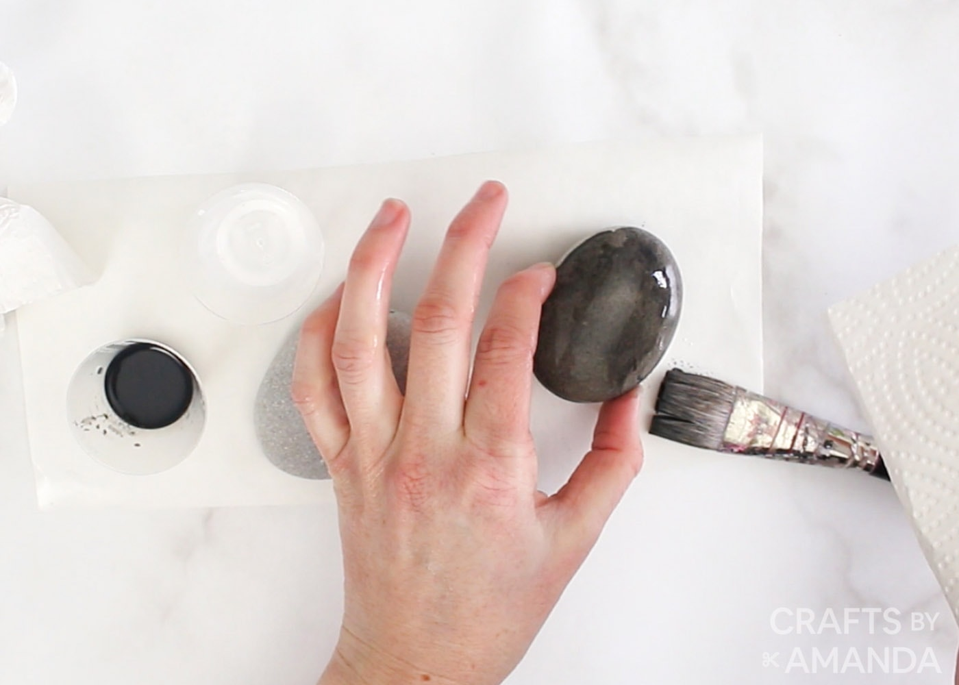 painting rock with watered down black paint