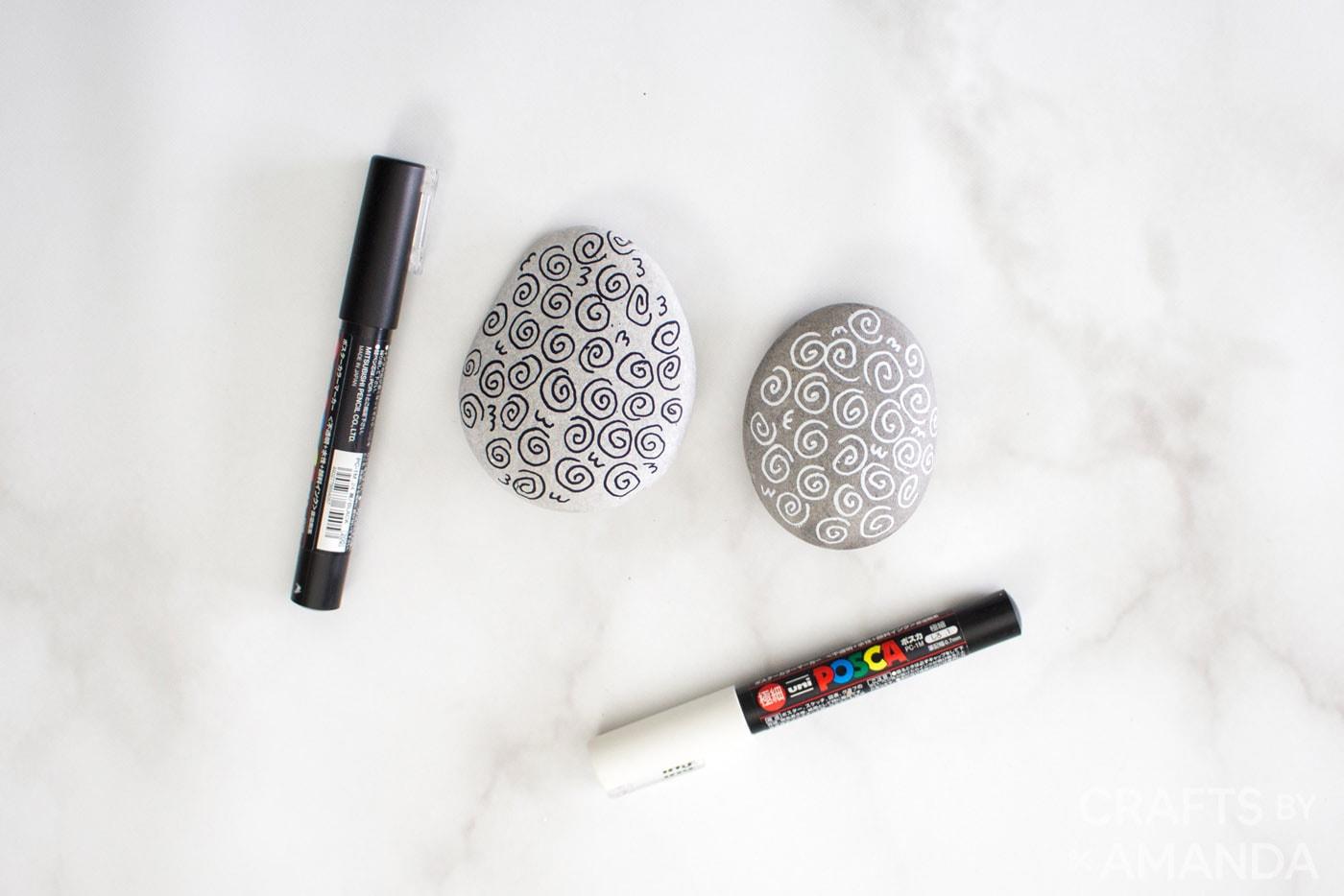 spirals drawn on rocks using a paint pen
