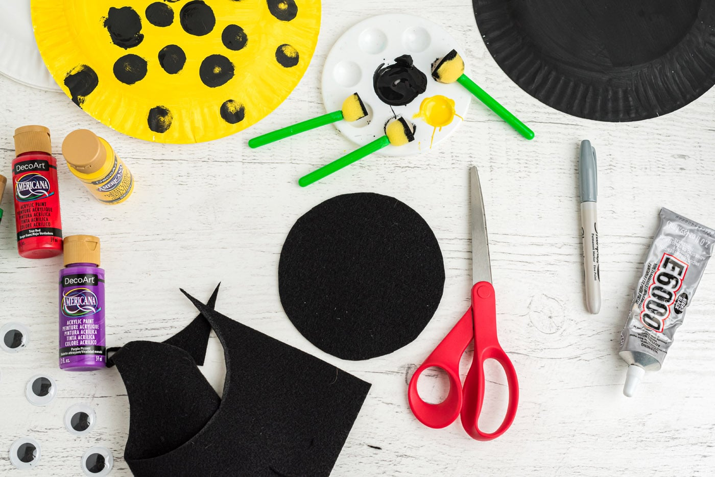 black felt cut into a circle with scissors
