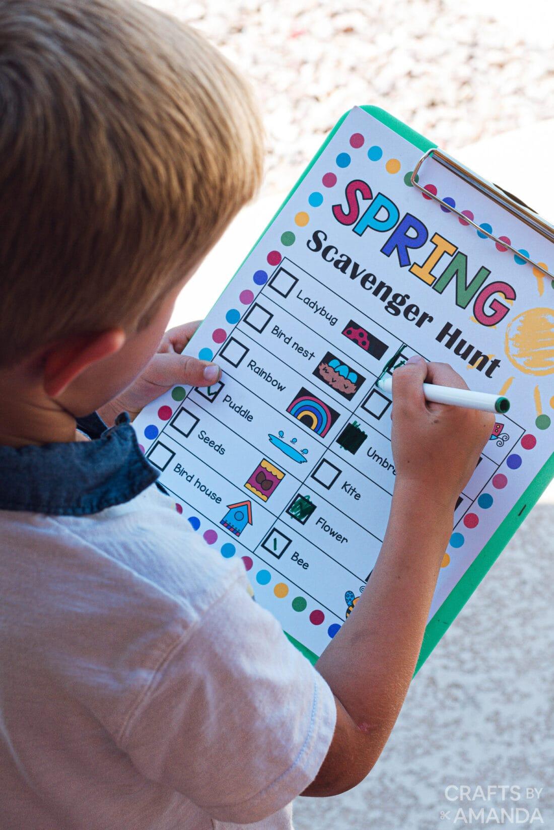 child checking off item on list