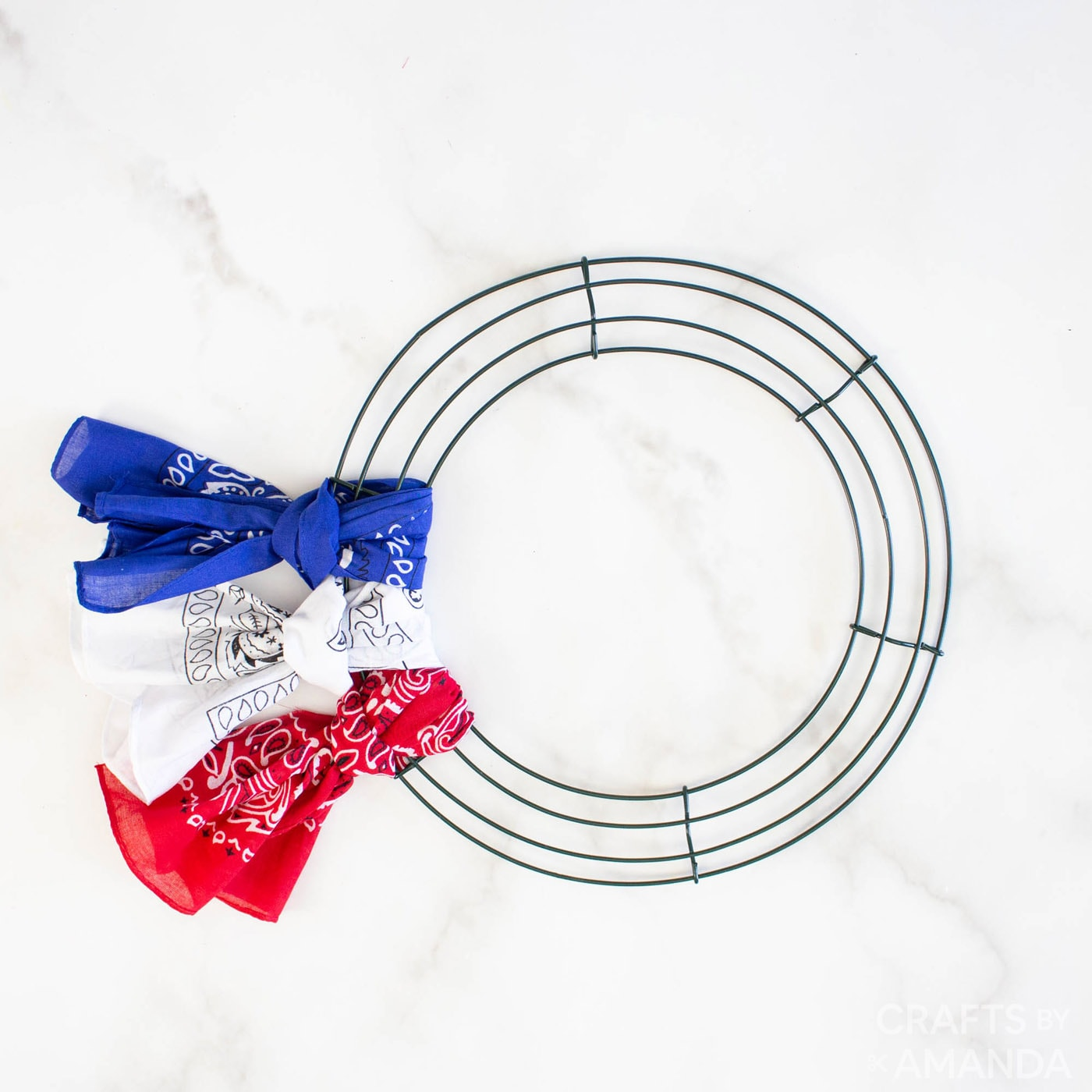 red white and blue bandanas tied to a wreath form