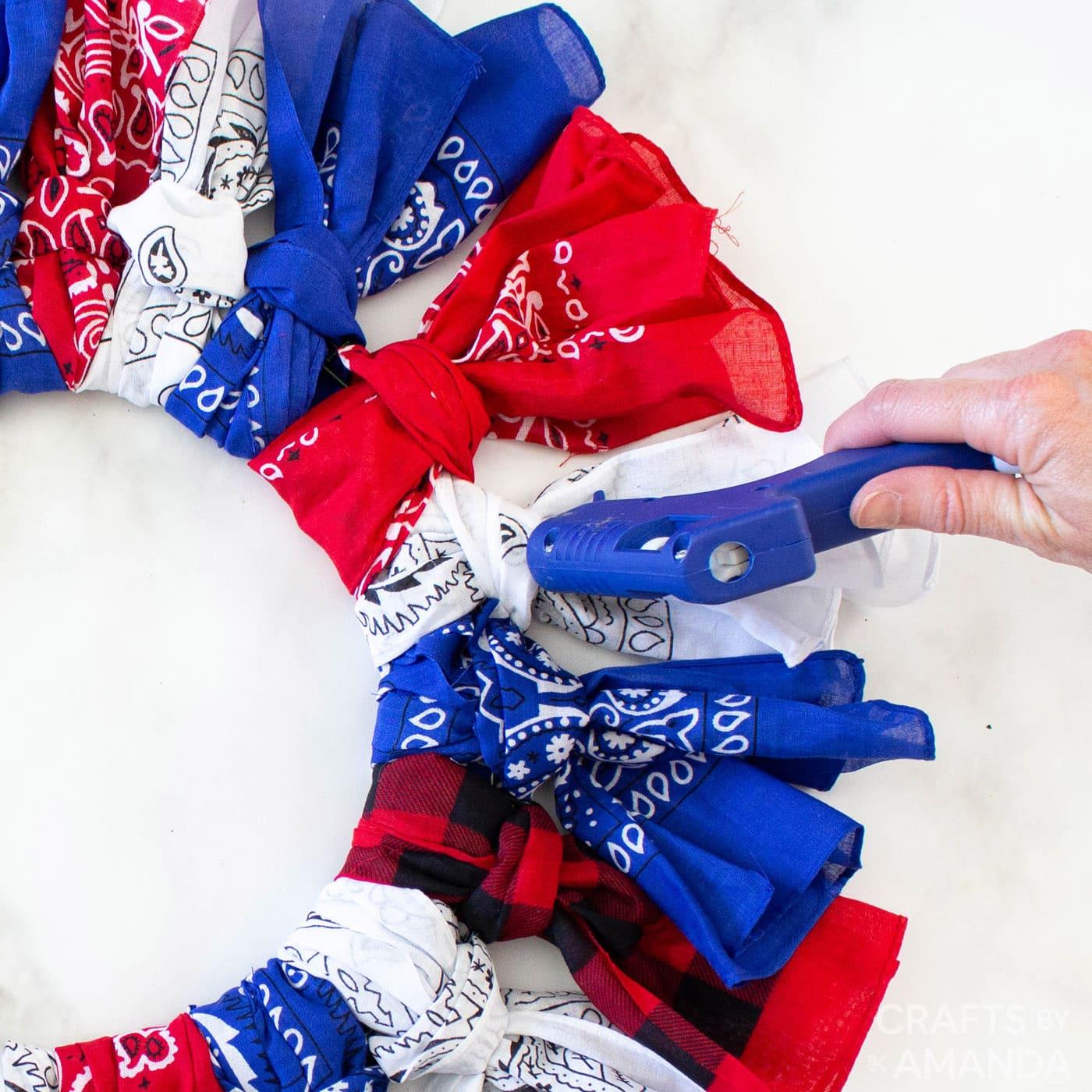 applying hot glue to bandana knots
