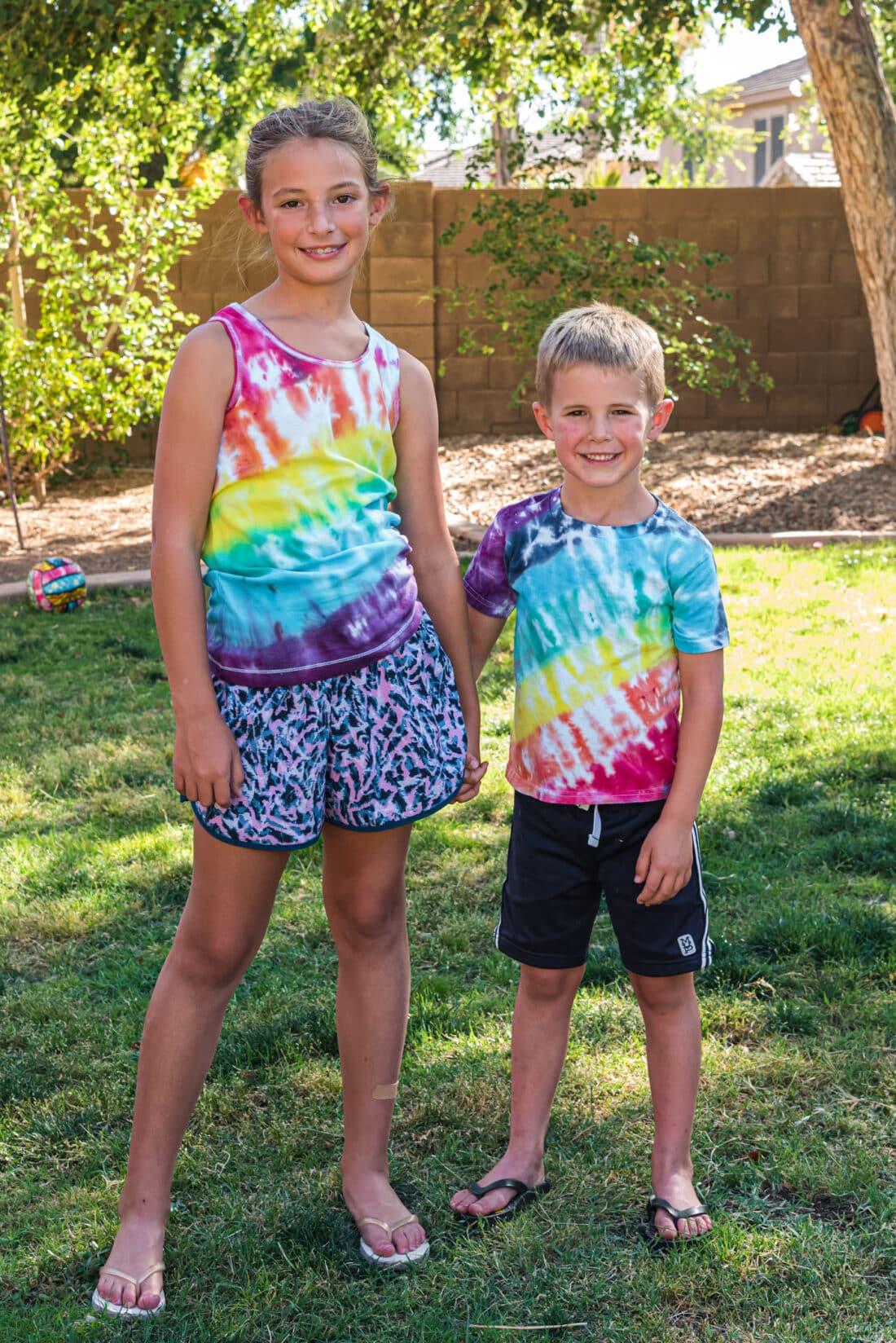 kids wearing rainbow tie dye shirts