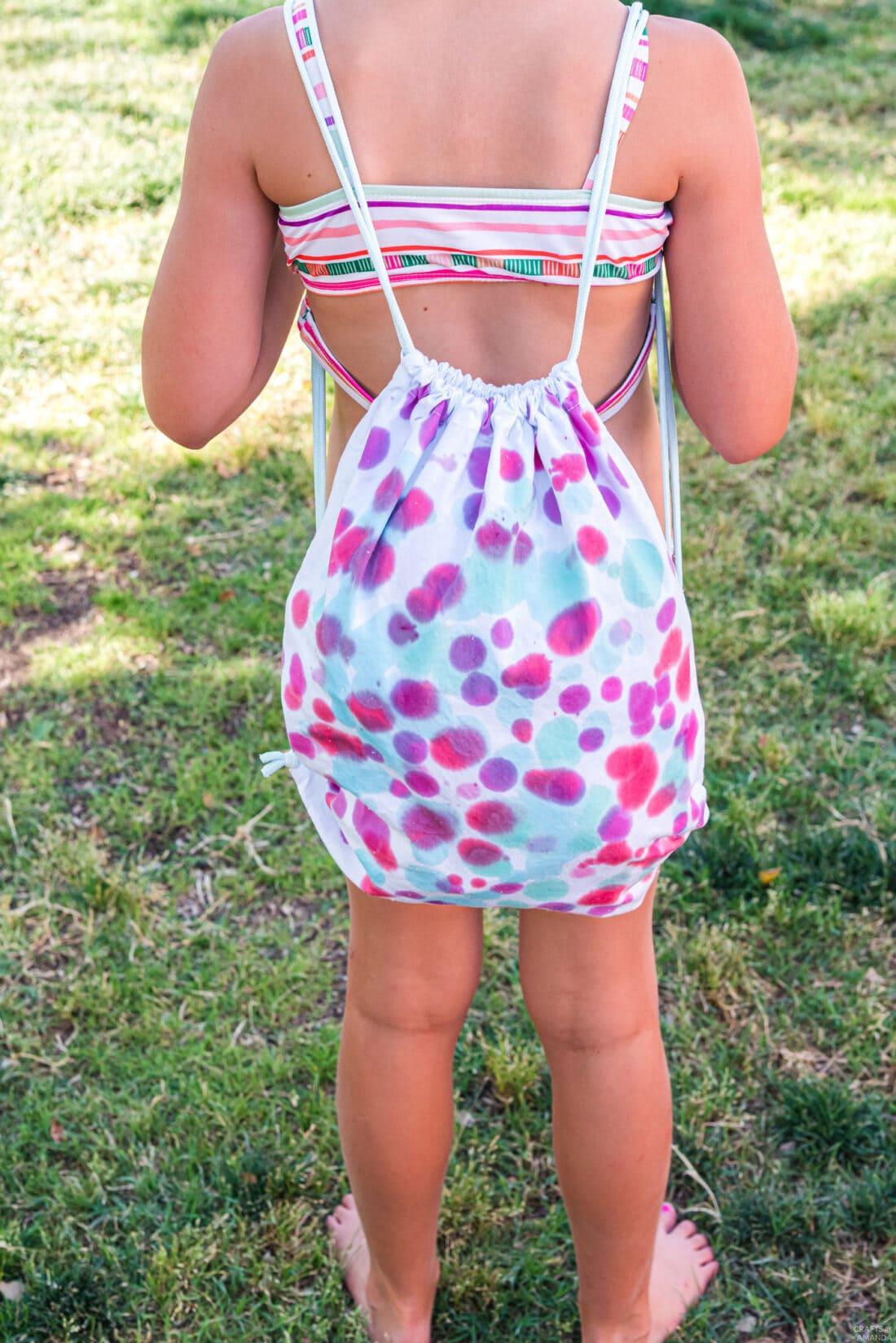 child wearing a Drip Tie Dye Backpack