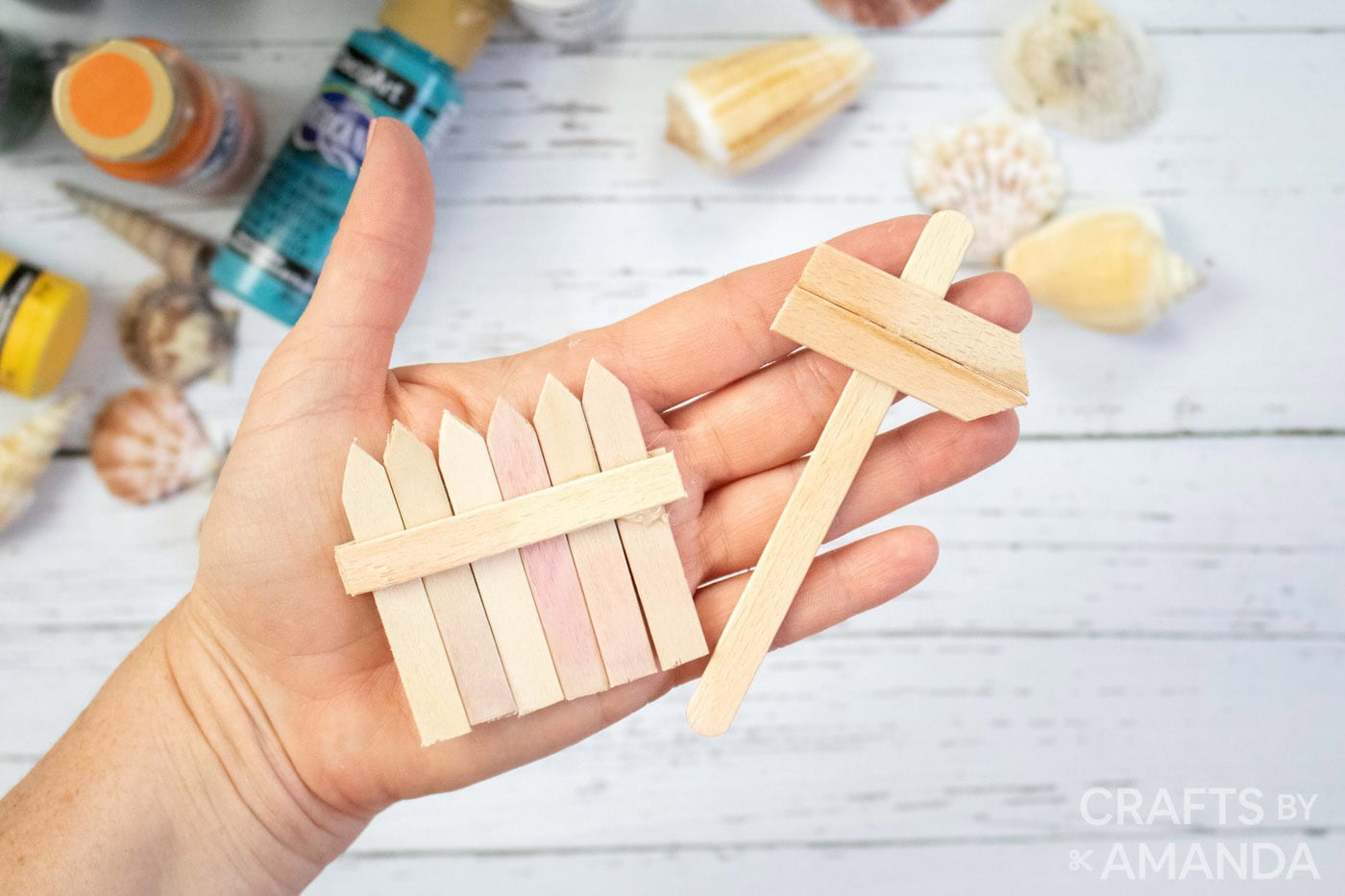 popsicle stick sign and fence