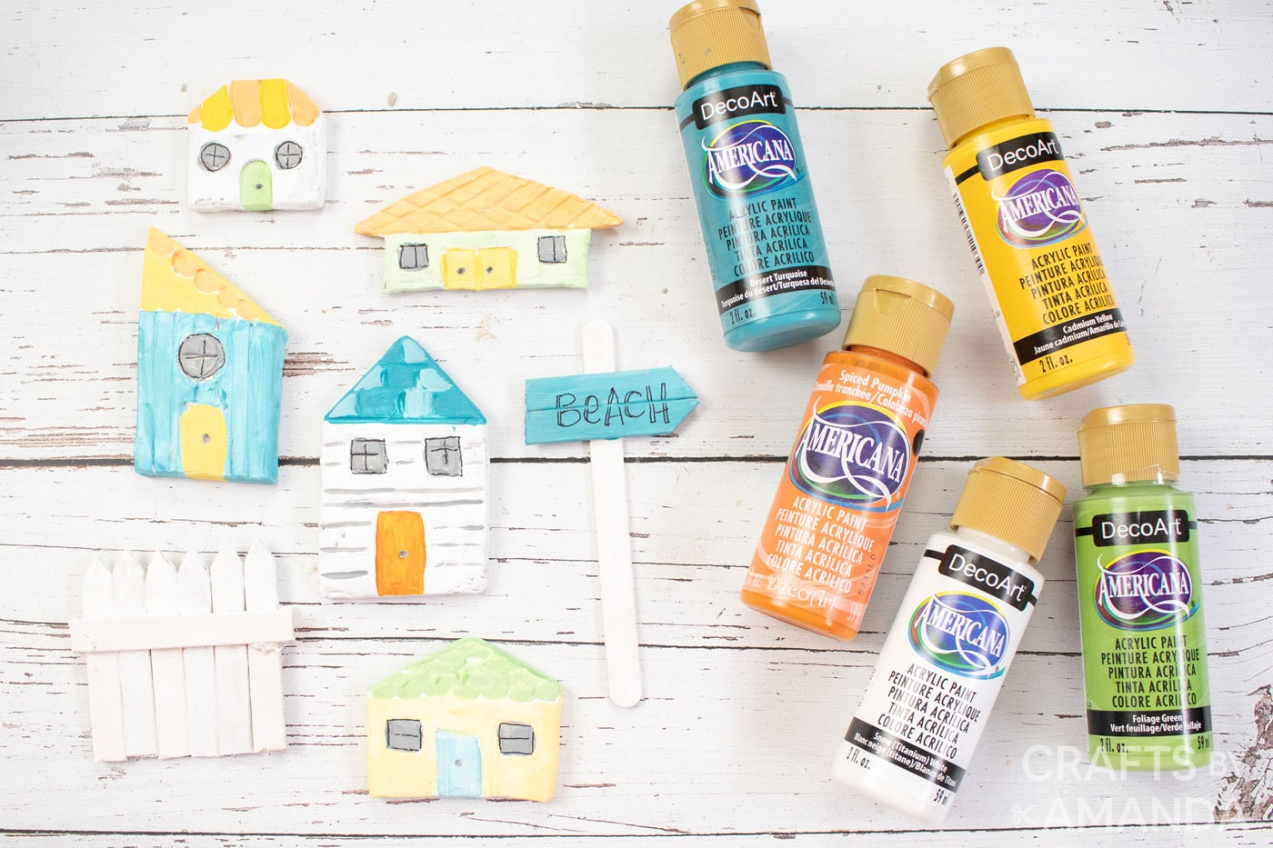 coastal painted clay houses and popsicle stick fence. Decoart paints